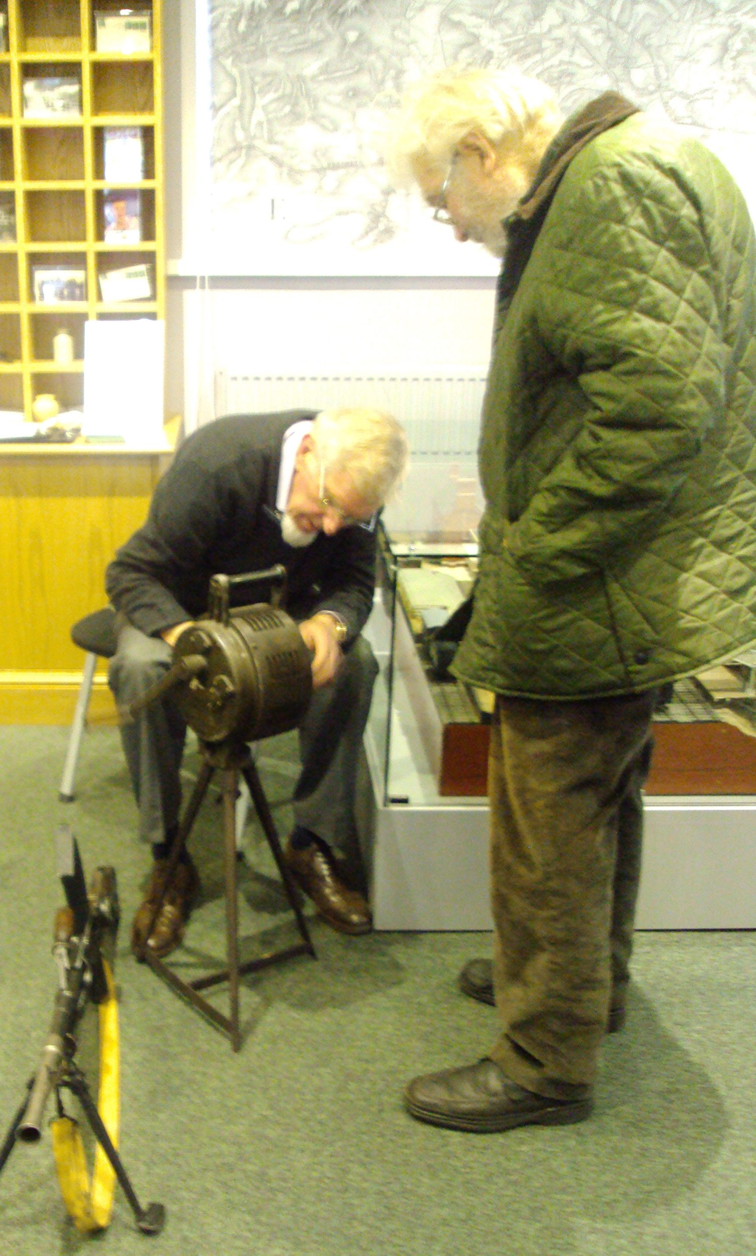 Roger Money and visitor inspecting the Air Raid Siren