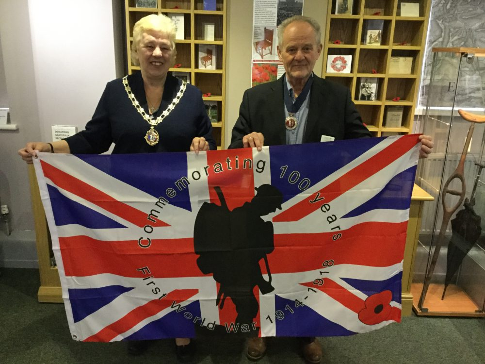 Cllr Lynn Jones, Mayor of Daventry and Cllr Mike Arnold, Deputy Mayor of Daventry holding flag to commemorate 100 years since the First World War.