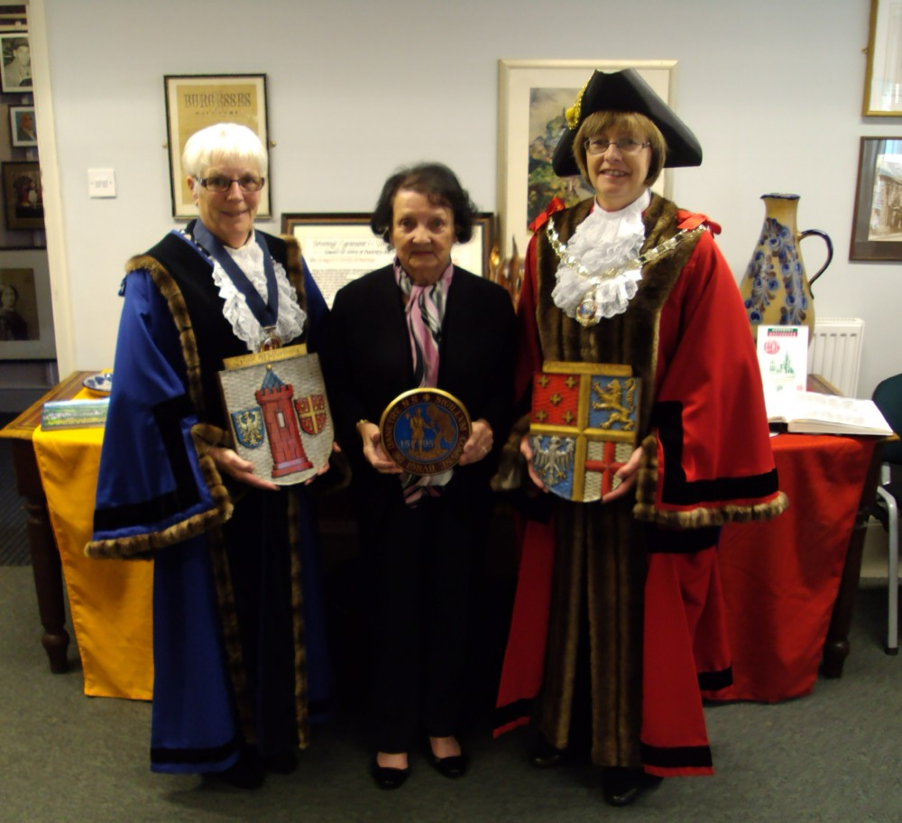 From left, deputy mayor of Daventry Cllr Glenda Simmonds holding the Westerburg town coat of arms, chairman of Daventry Twinning Association Mavis Matthews holding the Seal of Daventry, and Mayor of Daventry Cllr Wendy Randall holding the Westerburg district coat of arms.
