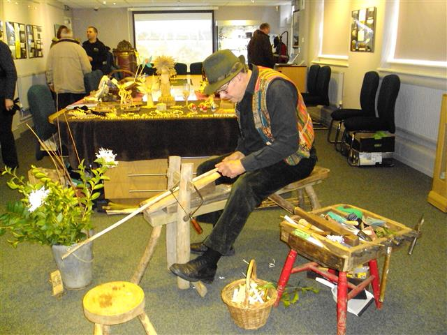 Bert Manton demonstrating traditional rural crafts.