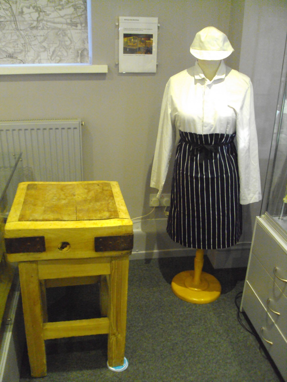 Old Butcher's block and butcher's outfit loaned by Gilling's Butchers, Bowen Square, Daventry