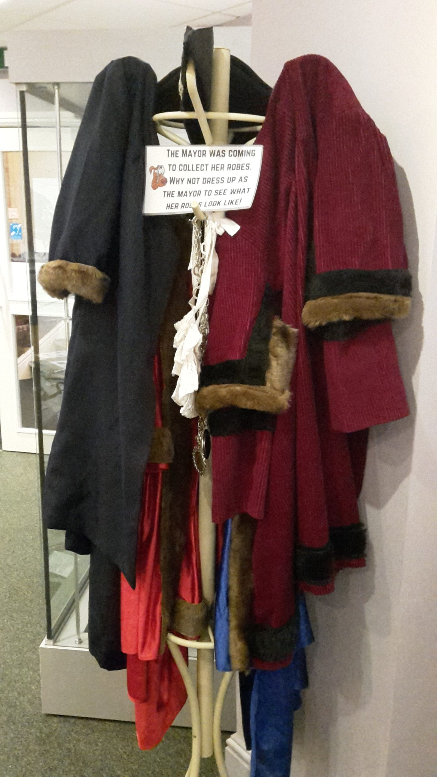 Image of Mayor robes on display for visitors to wear.