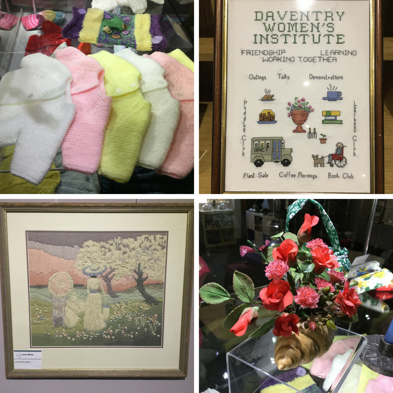 Premature knitted baby jackets; Daventry WI in cross stitch; Long stitch picture by June White; and a spray of flowers in sugar craft by Jean Gosling.