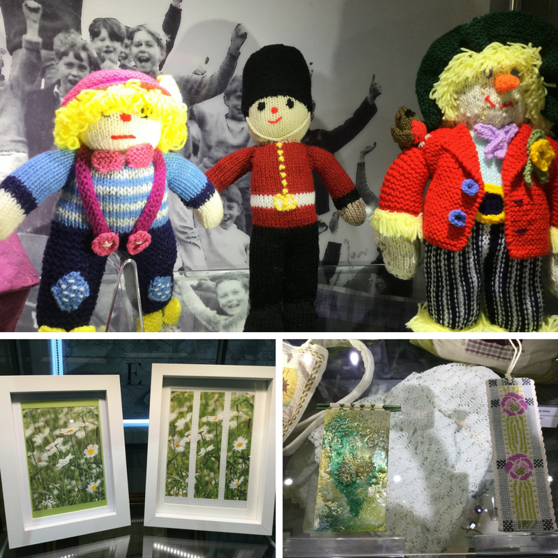 Picture shows 3 knitted dolls by Zoe Meacock; Wildflower photographs and enamel covered note book by Wendy Bates; and a cross stitch book mark by Rosemary Brown.