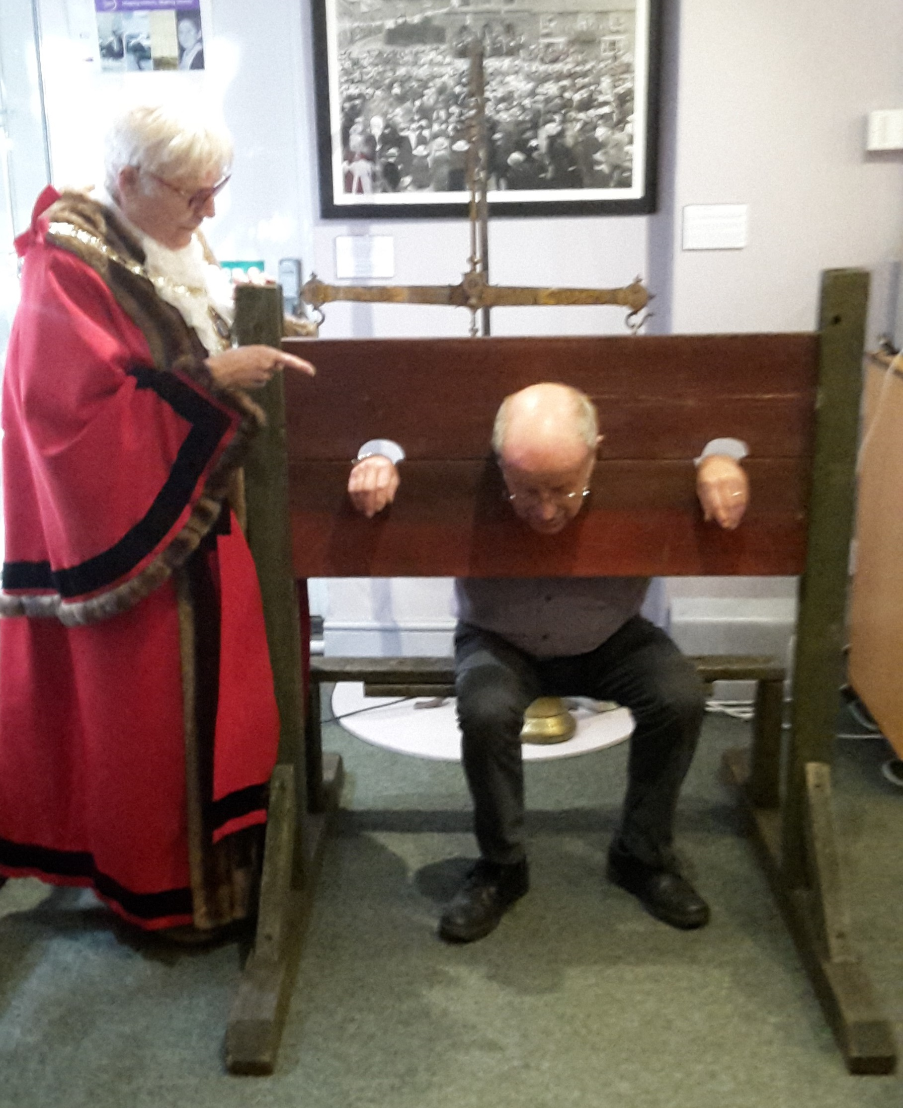 Mayor of Daventry, Councillor Glenda Simmonds and Volunteer Curator, Rod Viveash in the Pillory