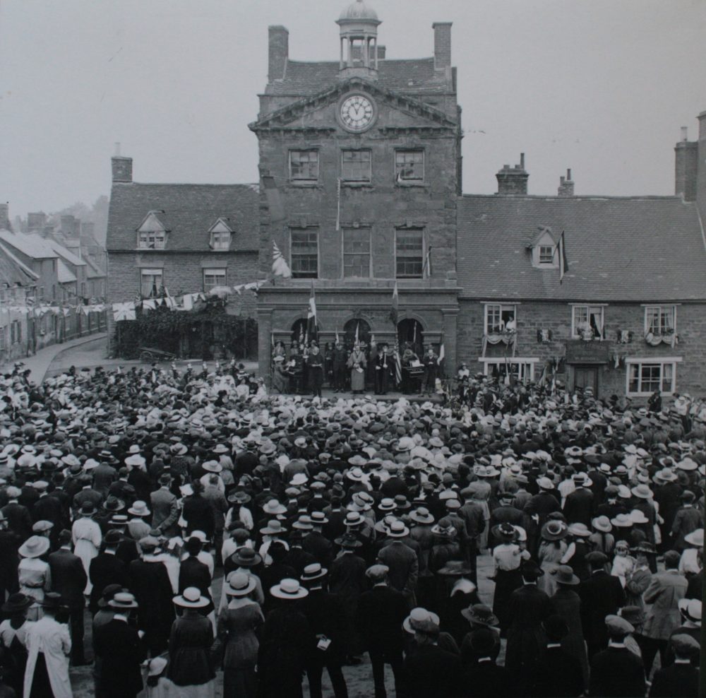 Black and white image of Peace Day 19th July, 1919 in Daventry showing crowded town centre.