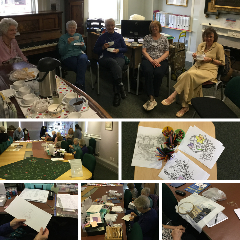 Members of the WI enjoying a tea break with homemade shortbread, having been busy crafting!